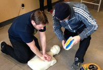 two cpr training students