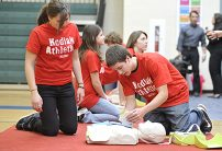students doing cpr training in gym
