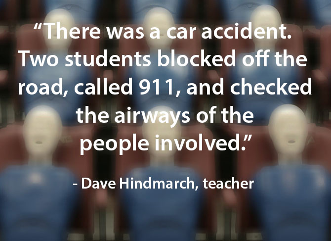 students take charge during a car accident image