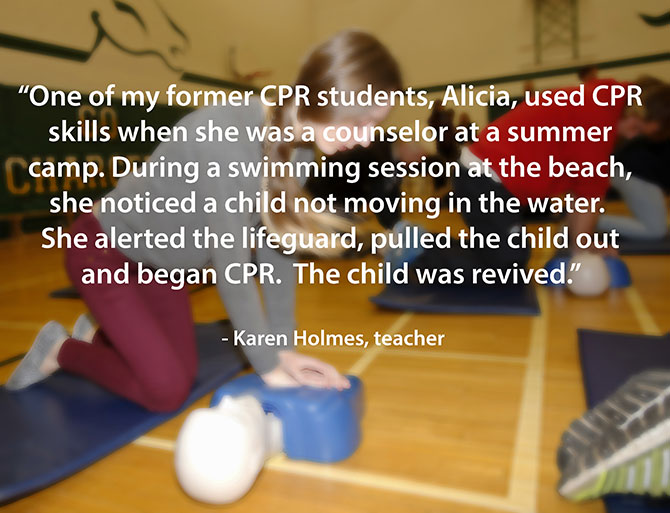 student saves young boy on the beach with CPR image