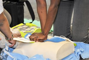 chest compressions on cpr dummy