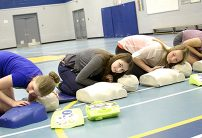 students doing cpr training in a gym