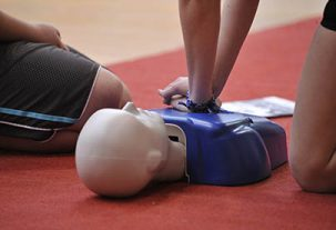 doing cpr training on mannequin