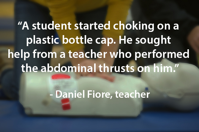 teacher helps student during choking incident image