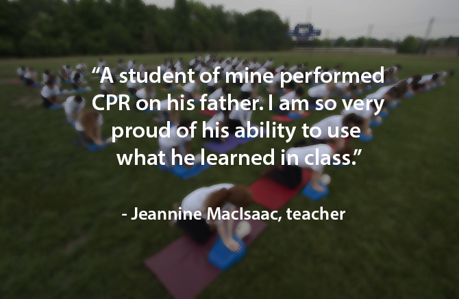 student performs CPR on dad image