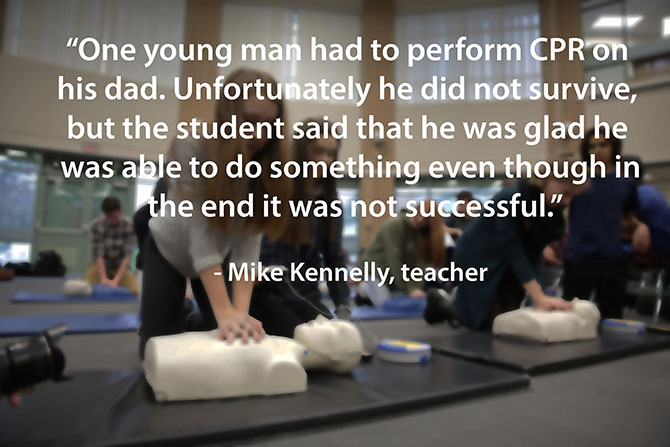 young man performs CPR on his dad image