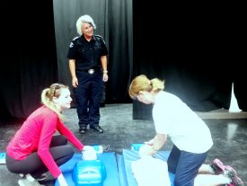 students doing cpr training with paramedic